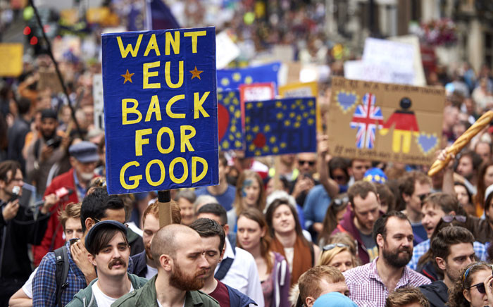 People hold up pro-Europe placards as thousands of protesters take part in a March for Europe, through the centre of London on July 2, 2016, to protest against Britain's vote to leave the EU. Picture: AFP.