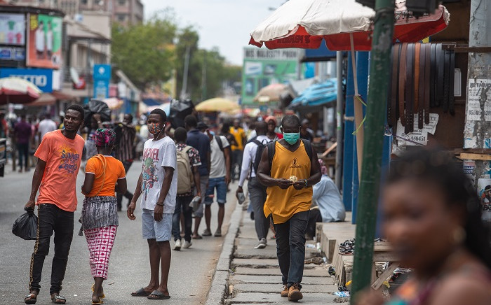 FILE: A man walks with a face mask at the Kantamanto market after the partial lockdown in parts of Ghana to halt the spread of the COVID-19 coronavirus was lifted in Accra, Ghana on 20 April 2020. Picture: AFP