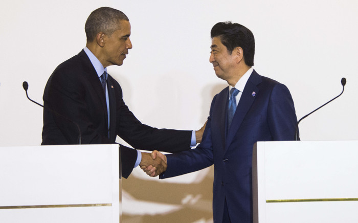 FILE: US President Barack Obama(L) shakes hands with Japanese Prime Minister Shinzo Abe during the Group of Seven (G7) summit meetings in Shima on May 25, 2016. Picture: AFP.
