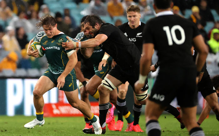 New Zealand's Sam Whitelock tackles Australia's Michael Hooper (L) during the Tri Nations and Bledisloe Cup rugby match between Australia and New Zealand in Sydney on 31 October 2020. Picture: AFP