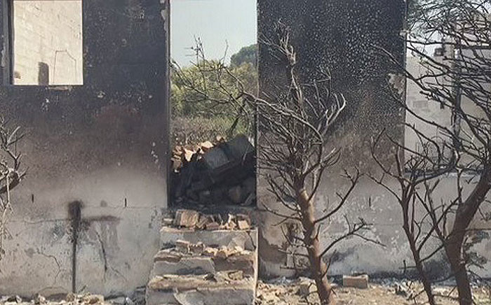 Many people were evacuated after a fire broke out along the Drakenstein Mountains overnight and destroyed structures. Picture: Natalie Malgas/EWN.