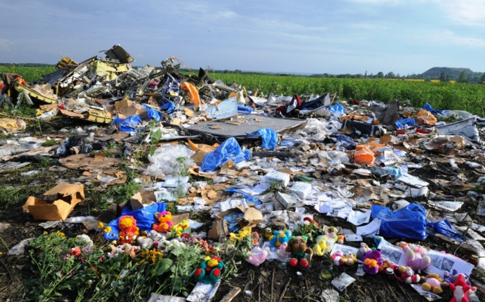 FILE: Flowers and toys are left at the site of the crash of a Malaysia Airlines plane carrying 298 people from Amsterdam to Kuala Lumpur in Hrabove, in rebel-held eastern Ukraine, on 19 July 2014. Picture: AFP.