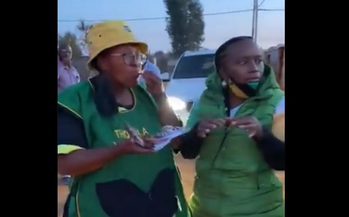 In the clip, the women can be heard mockingly speaking of the local economy while eating the chicken feet as a little boy watches on. Picture: Twitter screengrab.
