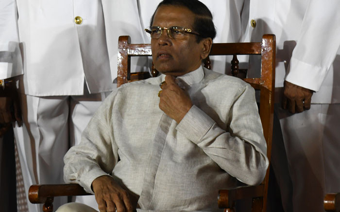 FILE: Sri Lanka's President Maithripala Sirisena (C) waits next to Navy officers for a group photo during a ceremony commissioning P 626 ship, US gifted to the Sri Lankan coastguard at the main port in Colombo on 6 June 2019. Picture: AFP
