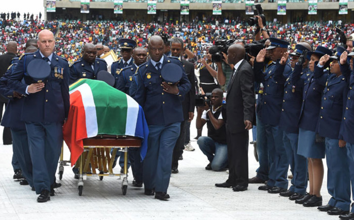 Police holding Senzo Meyiwa's casket ahead of his funeral service held at the Moses Mabhida Stadium on 1 November 2014. Picture: GCIS.