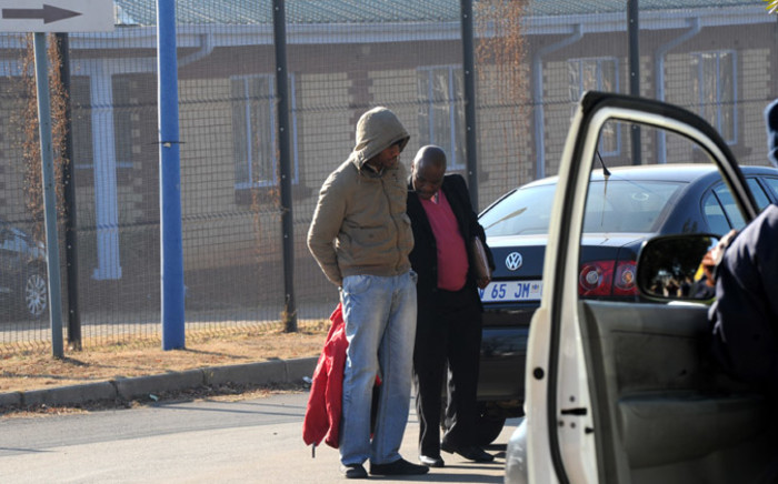 Donald Sebolai, known as DJ Donald Duck, arrives under police guard at the Protea Magistrate's Court in Soweto on 10 July 2014 ahead of his appearance in connection with the murder of his girlfriend. Picture: Sapa.