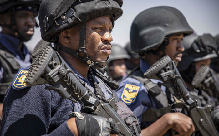 FILE: Members of the Tactical Response Team and the National Intervention Unit prepare for deployment into the Westbury area. Picture: Thomas Holder/EWN.