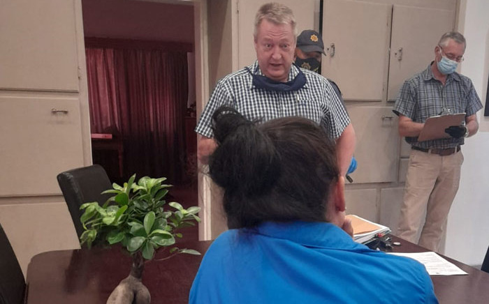 Northern Cape police arrest the widow of Leon Brits (in blue) for her alleged role in his death on 29 March 2021. Picture: SAPS