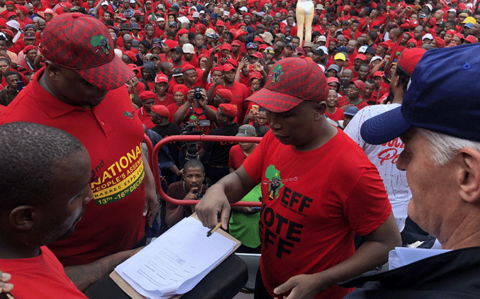 Economic Freedom Fighters (EFF) leader Julius Malema hands over a memorandum to Eskom CEO Andre de Ruyter after party supporters marched to the utility's head office in Sunninghill on 28 February 2020. Picture: Edwin Ntshidi/EWN.