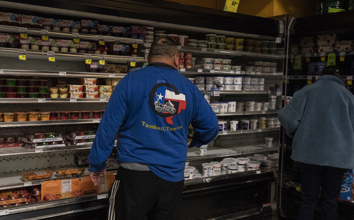 People shop in Fiesta supermarket on 17 February 2021 in Houston, Texas. Winter storm Uri has brought historic cold weather, power outages and traffic accidents to Texas as storms have swept across 26 states with a mix of freezing temperatures and precipitation. Picture; Go Nakamura/AFP