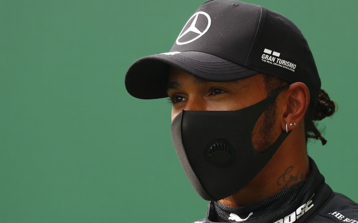 Mercedes' British driver Lewis Hamilton reacts after securing his 93rd pole position during the qualifying session at the Spa-Francorchamps circuit in Spa on 29 August 2020 ahead of the Belgian Formula One Grand Prix.Picture: AFP.