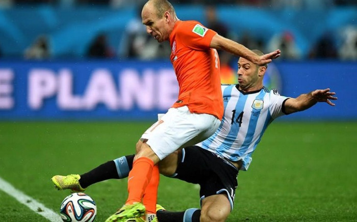 Argentina's Javier Mascherano puts in a trademark challenge to dispossess Holland's Arjen Robben. Picture: Official FIFA World Cup Facebook Page.