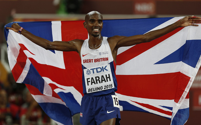 """FILE: Britain's Mo Farah celebrates winning the final of the men's 5000 metres athletics event at the 2015 IAAF World Championships at the """"Bird's Nest"""" National Stadium in Beijing on 29 August, 2015. Picture: AFP."""