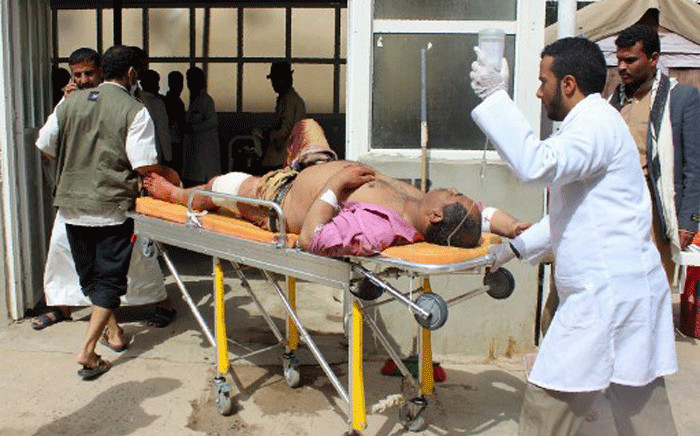 A man is transported to a hospital after he was wounded in a reported air strike on the Iran-backed Huthi rebels' stronghold province of Saada on 9 August, 2018. Picture: AFP