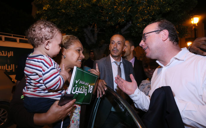 Elyes Fakhfakh, a Tunisian presidential candidate, speaks with a supporter during an electoral campaign in Tunis on September 12, 2019, ahead of the first round of elections on 12 September 2019. Picture: AFP
