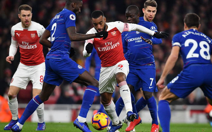 Arsenal striker Alexandre Lacazette (C) vies with Chelsea's Antonio Rudiger (2nd L) and N'Golo Kante (3rd R) during their English Premier League football match at the Emirates Stadium in London on 19 January 2019. Picture: AFP