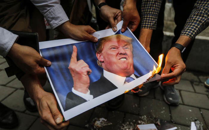 FILE: Iranians burn an image of US President Donald Trump during an anti-US demonstration outside the former US embassy headquarters in the capital Tehran  Picture: AFP