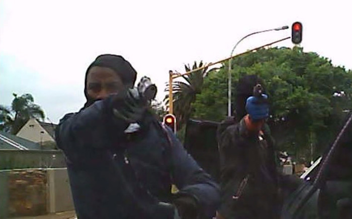 A screengrab picture of the hijacking of a motorist by a group of heavily armed men on 22 September 2015.