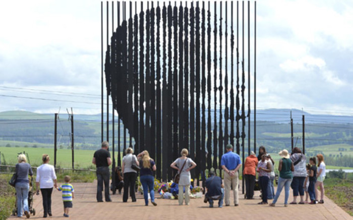 People pay their respects former president Nelson Mandela at the site where he was arrested outside Howick in 1962. Picture: Reinhardt Hartzenberg/EWN.