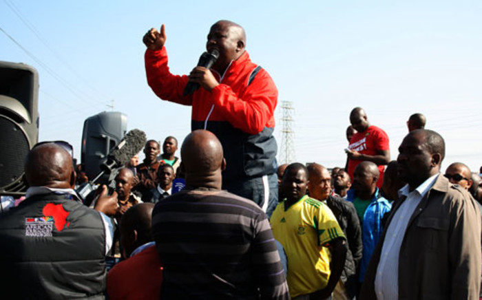 Expelled ANC Youth League President Julius Malema is seen addressing striking mineworkers at Lonmin's Marikana operations on Saturday, 18 August 2012. Picture: Sapa.