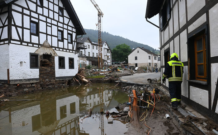 A fireman walks along the edge of a destroyed street after floods caused major damage in Schuld near Bad Neuenahr-Ahrweiler, western Germany, on 17 July 2021. Picture: CHRISTOF STACHE/AFP