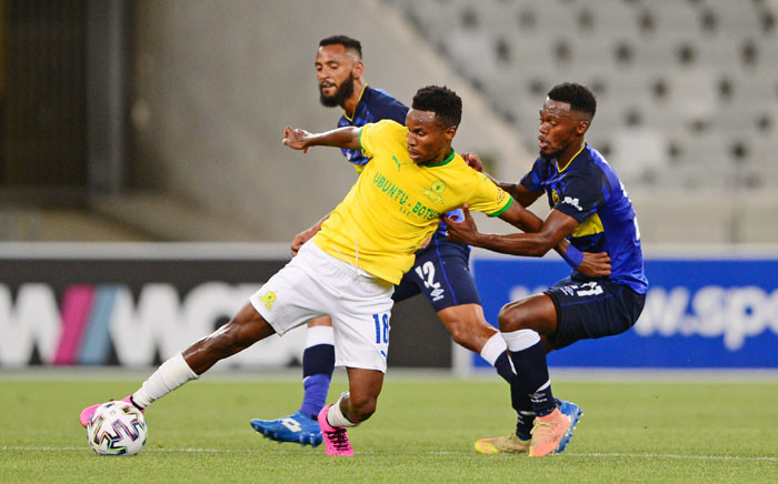 Mamelodi Sundowns' Themba Zwane holds off two Cape Town City FC players during their DStv Premiership match in Cape Town on 4 November 2020. Picture: @Masandawana/Twitter