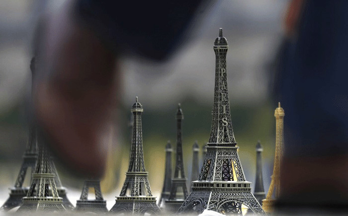 FILE: A picture shows miniature Eiffel Towers in Paris, on November 16, 2017. Picture: AFP.