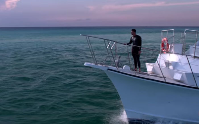 A screengrab of Michael Phelps about to race a great white shark.