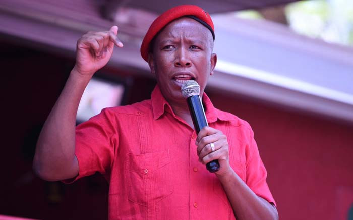 Economic Freedom Fighters leader Julius Malema addresses party supporters on 27 November 2018 outside Brooklyn Police Station in Pretoria. The EFF has laid criminal complaints against Public Enterprises Minister Pravin Gordhan at the station. Picture: @EFFSouthAfrica /Twitter