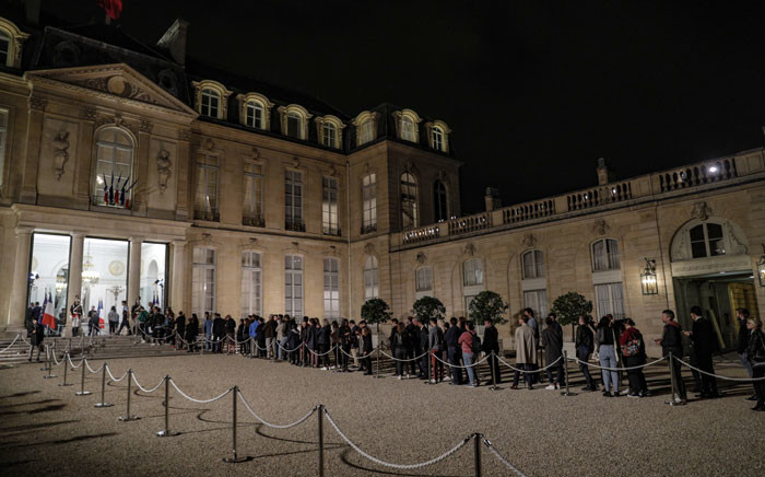 People queue in the courtyard of the Elysee presidential palace in Paris on 26 September 2019 to sign a condolence register for late former French President Jacques Chirac after the announcement of his death today at the age of 86 after a long battle with ill-health, his family said. Picture: AFP