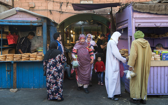 FILE: People shop a market in the Moroccan-controlled Western Sahara's main city of Laayoune on 3 November 2018. Picture: AFP.