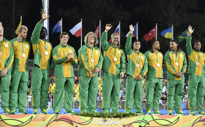 The South African Rugby Sevens team celebrates on the podium during the medal ceremony at the Rio 2016 Olympic Games at Deodoro Stadium in Rio de Janeiro onAugust 11, 2016. Picture: AFP