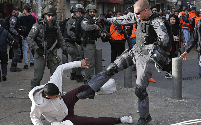 Israeli security forces scuffle with Palestinian protesters just outside Jerusalem's Old City on 15 December 2017. Picture: AFP
