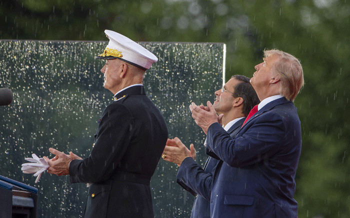 """President Donald Trump watches a flyover on 4 July, 2019 in Washington, DC. President Trump is holding a """"Salute to America"""" celebration on the National Mall on Independence Day this year with musical performances, a military flyover, and fireworks. Picture: AFP."""