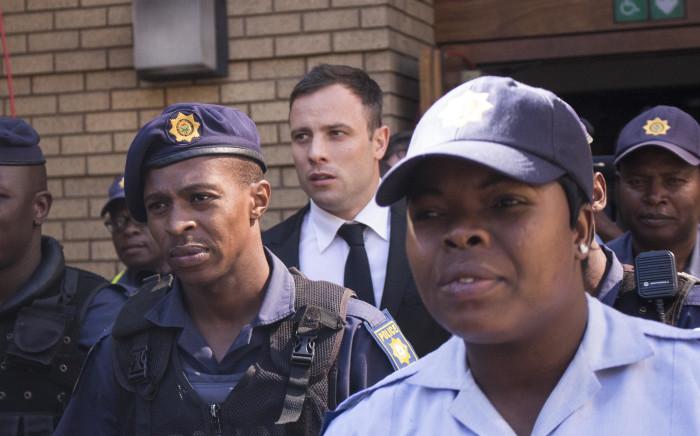 Oscar Pistorius leaves the Pretoria High Court on 16 October 2014. Picture: Christa Eybers/EWN.