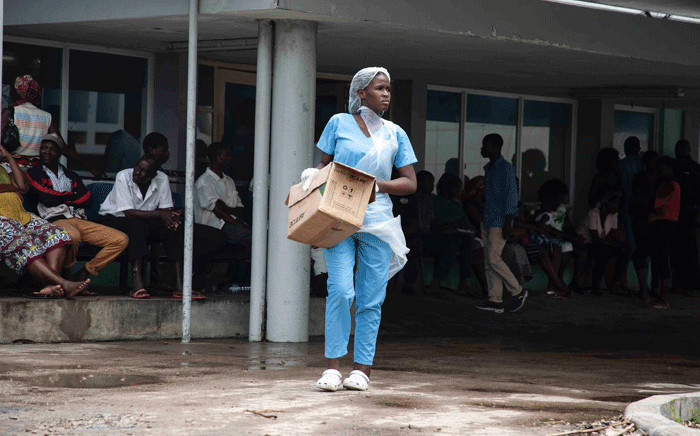A nurse carries supplies at the Central Hospital of Beira after Cyclone Idai swept through the city. Picture: Christa Eybers/EWN.