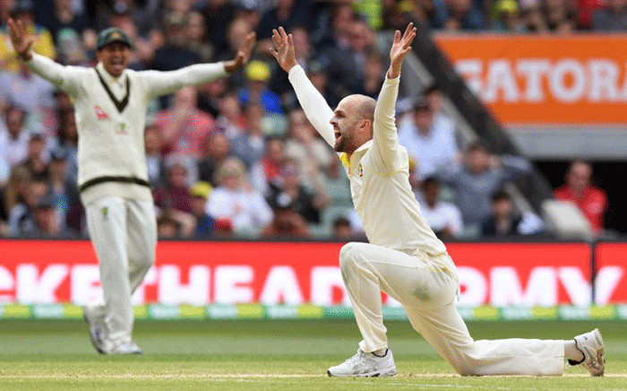 FILE: Australia's spinner Nathan Lyon (R) appeals successfully for an LBW decision against England's batsman Alastair Cook on the fourth day of the second Ashes cricket Test match in Adelaide in December 5, 2017. Picture: AFP