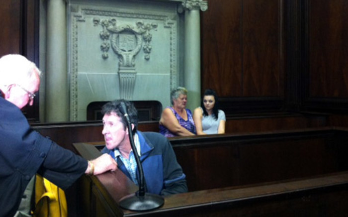 Murder accused Johannes de Jager chats to his lawyer while Charmaine Mare's mother and friend wait for proceedings to get underway. Picture: Graeme Raubenheimer/EWN