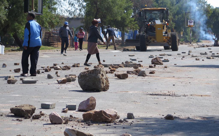 FILE: Khumalo Street was strewn with debris after scores of angry protesters took to the streets in Orlando West, in Soweto to protest against Eskom's pre-paid meters. Picture: Louise McAuliffe/EWN.