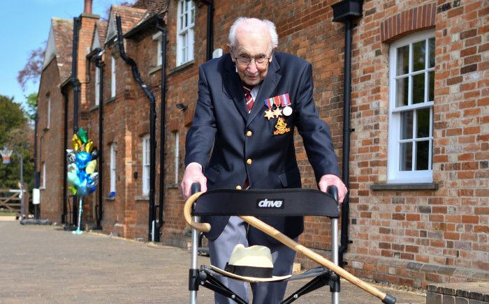 FILE: British World War II veteran Captain Tom Moore, 99, poses doing a lap of his garden in the village of Marston Moretaine, 50 miles north of London, on April 16, 2020. A World War II veteran who has raised millions of pounds for charity by walking around his garden on Friday became the oldest man to top the UK music charts -- just days from his 100th birthday. Picture: AFP