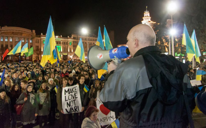 A Pro-Ukrainian activist speaks during a rally in the center of the eastern Ukrainian city of Kharkiv on 6 March2014, to protest against Russian aggression in Crimea. Picture: AFP.