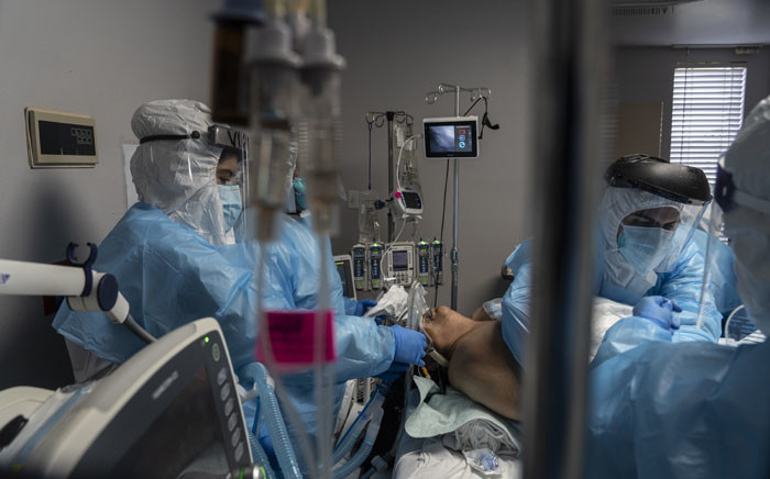 FILE: Medical staff members treat a patient suffering from the coronavirus disease in the COVID-19 intensive care unit at the United Memorial Medical Centre on 31 October 2020 in Houston, Texas. Picture: AFP.