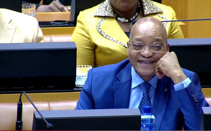 A screengrab of President Jacob Zuma laughing in Parliament.