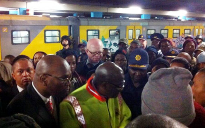 Police Minister Nathi Mthethwa listens to commuters concerns about train safety at Cape Town stations.