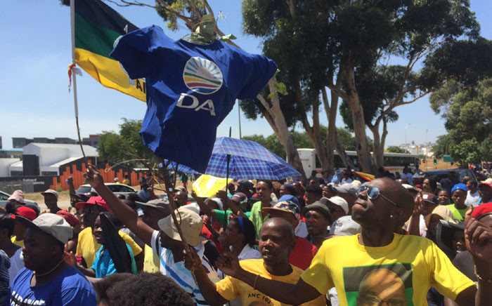 Demonstrators are in full voice singing old liberation struggle songs as they wait for more people to arrive. Picture: Vumani Mkhize/EWN.