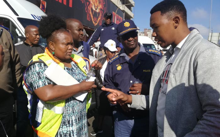 Gauteng Community Safety MEC Nkosi-Malobane and SA Police Service Lieutenant-General Elias Mawela out on the streets on Johannesburg City to deal decisively with lawlessness. Picture: @GP_CommSafety/Twitter