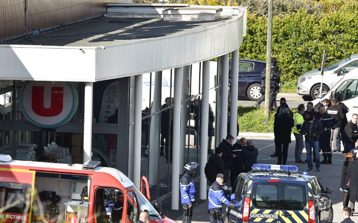 French security and police gather outside the Super U supermarket in the town of Trebes, southern France, where a man took hostages killing at least two before he was killed by security forces on March 23, 2018. Picture: AFP.