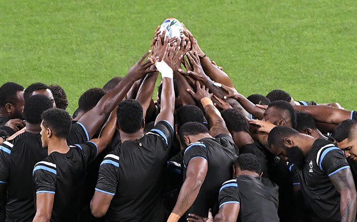 Fiji players pray at the start of the team's Captain's Run in Sapporo on 20 September 2019, ahead of the Japan 2019 Rugby World Cup. Picture: AFP