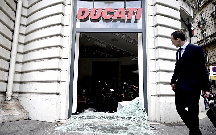 This picture taken on 12 July 2019, shows a broken window on the Avenue de la Grande Armee, near the Arc de Triomphe in Paris where Algerian supporters celebrated the victory of their team during the 2019 Africa Cup of Nations (CAN) quarter-final football match. Picture: AFP