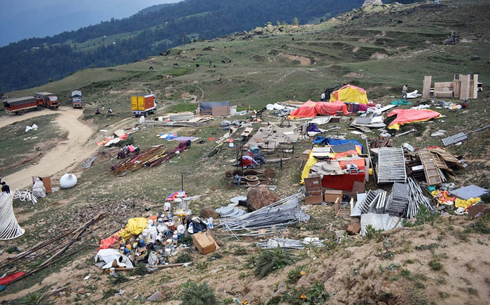 A general view shows waste left behind following the large-scale weddings of the brothers Suryakant and Shashank Gupta of the South Africa-based Gupta family, following days of celebrations in the Auli hill station in Uttarakhand state on 24 June 2019. Picture: AFP